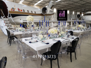 High gloss white rectangular tables. 1.2 by 2.4 meters, seats 12 guest, a