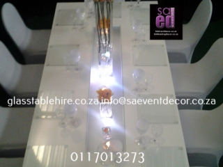 High gloss white rectangular tables. 1.2 by 2.4 meters, seats 12 guest q