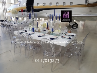 High gloss white rectangular tables. 1.2 by 2.4 meters, seats 12 guest, b