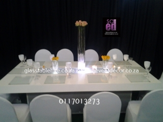 High gloss white rectangular tables. 1.2 by 2.4 meters, seats 12 guest p